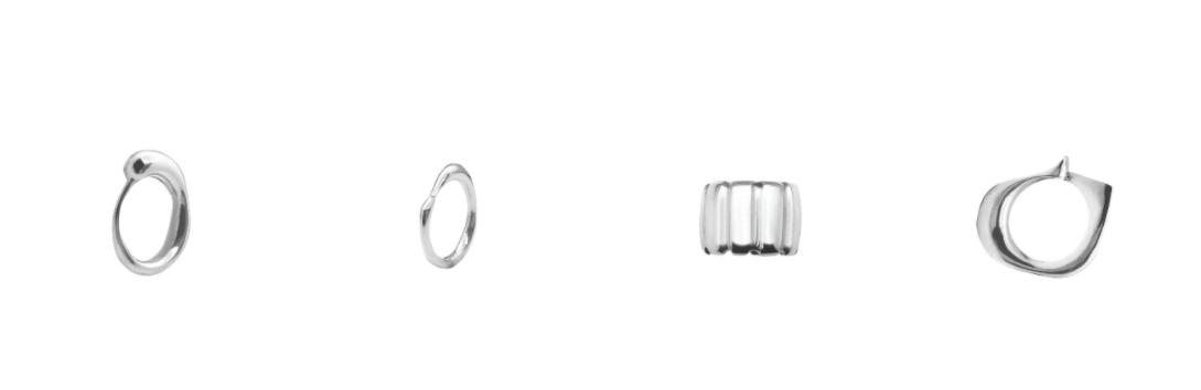 různé stříbrné prsteny